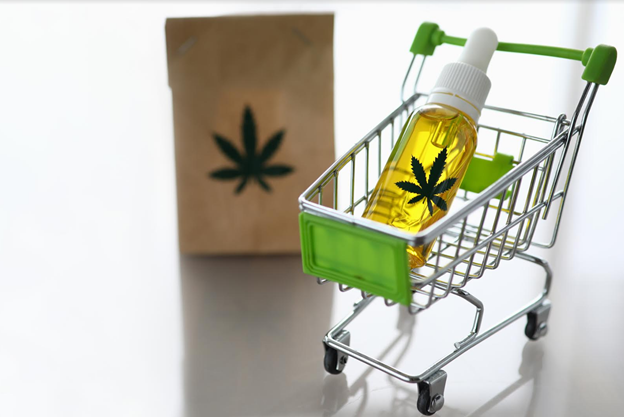 Cart from the supermarket with bottle of hemp oil