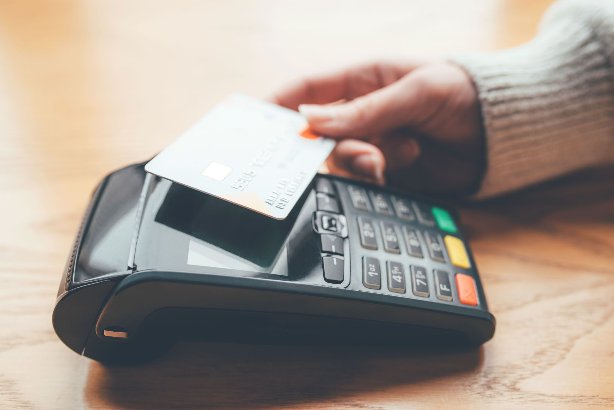 : A contactless POS system, one of the many merchant services for small businesses offered by Adept Payments.