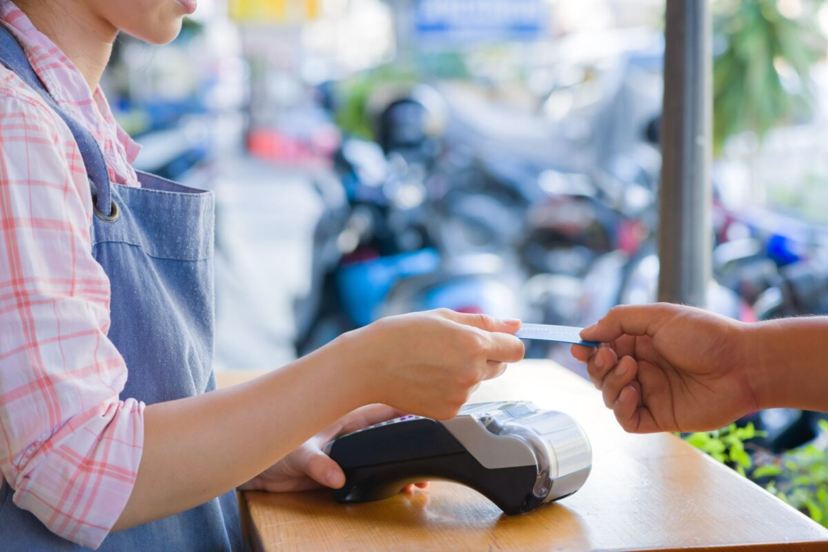 A customer paying with their credit card at a small business store.