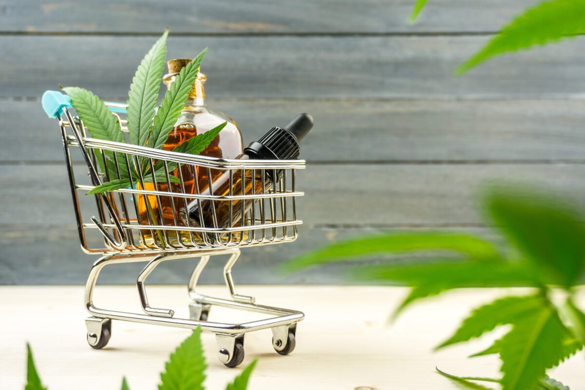 A toy supermarket trolley with CBD products, representing the potential of the CBD market and the need for trusted CBD merchant account providers.